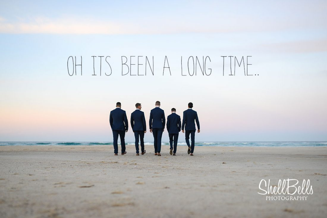 groomsmen on the beach wedding day sunset